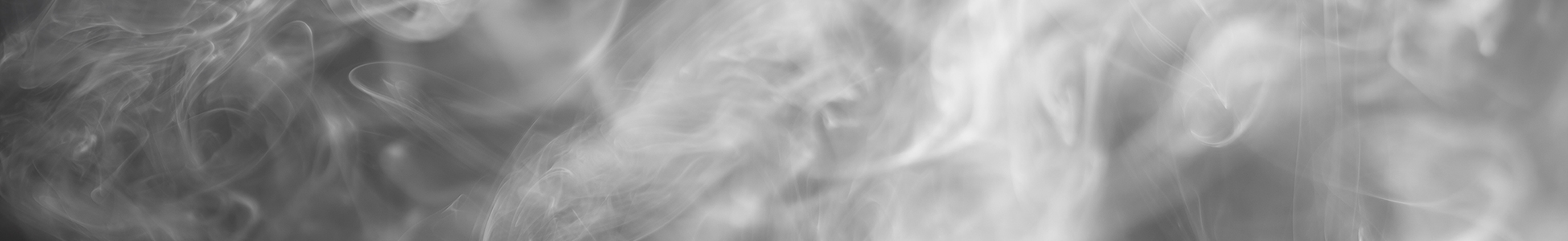 White smoke slowly rising on black background