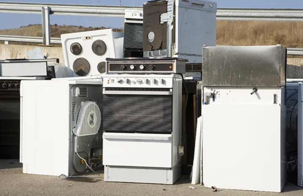 Old appliances stacked outside