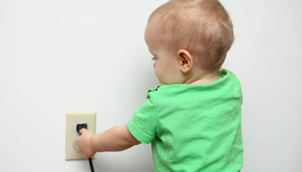 Toddler pulling chord from outlet