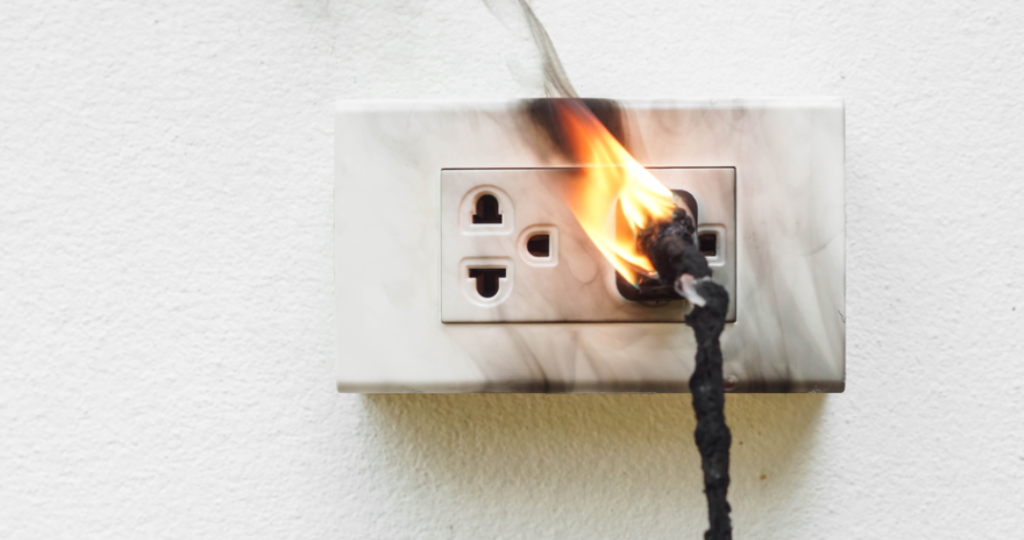 White electrical outlet on fire.